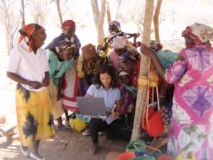Mungwi Women & Alejandra showing them the Sales plan, Kenya